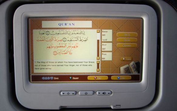 Digital Reader for the Qur'an in the back of an airplane seat.