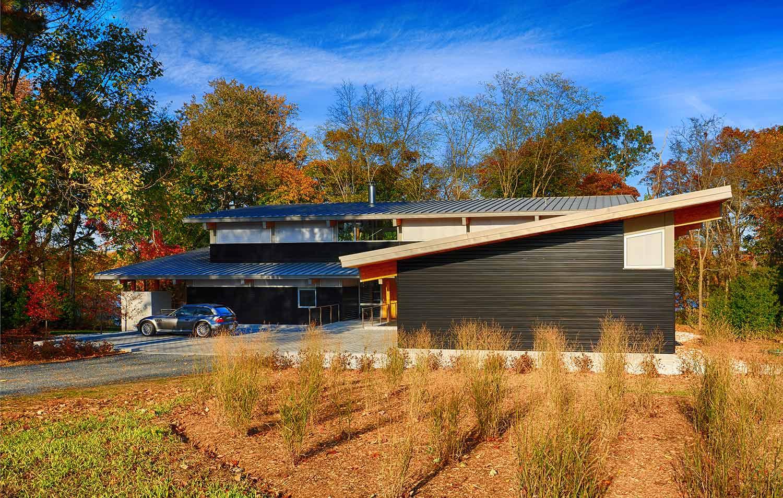 Modern timber frame house for Modern a frame homes