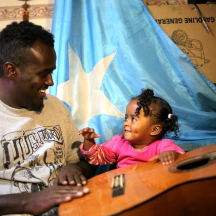 LFM 1.01- Shiine Akhyaar and his daughter, Sirad, in Nairobi, in the opening scene of Live from Mogadishu. Photo by Jake Simkin.