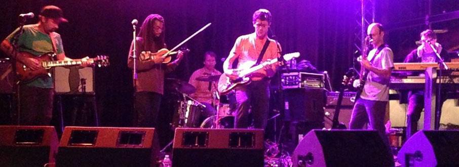 Humbucker is (left to right): David Burger (guitar), Robert Murphy (violin), James Movius (drums), Roddy Scheer (guitar), Jeff Ranish (bass), and Robert Fleming-Jones (keyboards).