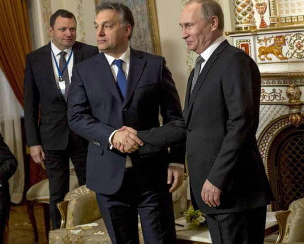 Ernő Keskeny, standing in the background on the left, Moscow, December 2014