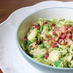 Shaved Brussels Sprout Salad with warm pancetta vinaigrette and walnuts