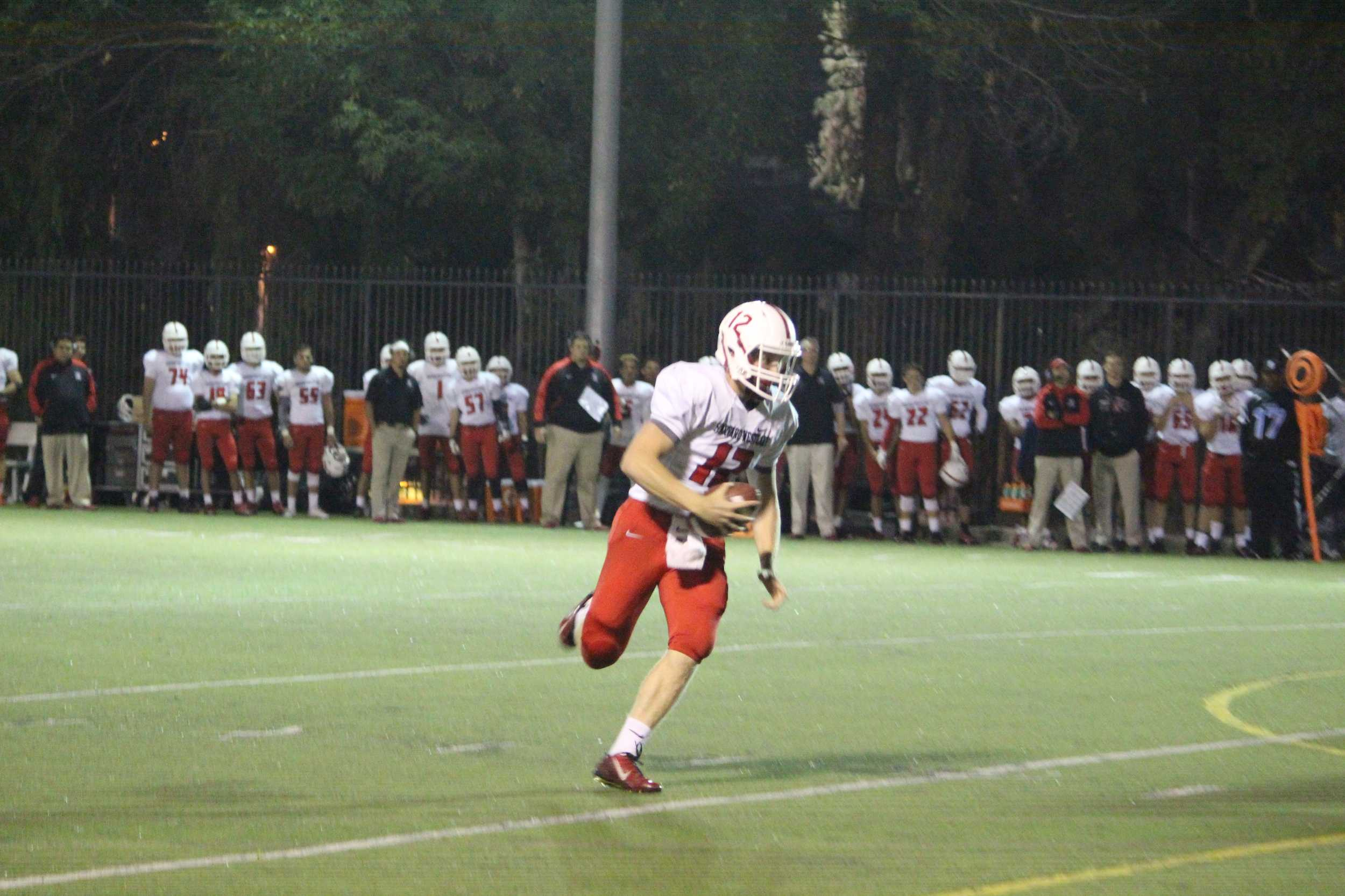 Quarterback Noah Rothman '16 scampers for an eight-yard touchdown run during the third quarter.