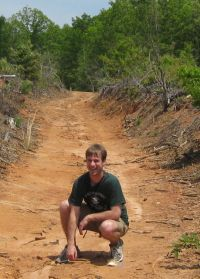 Kris on a forest road at Reynolds Homestead.