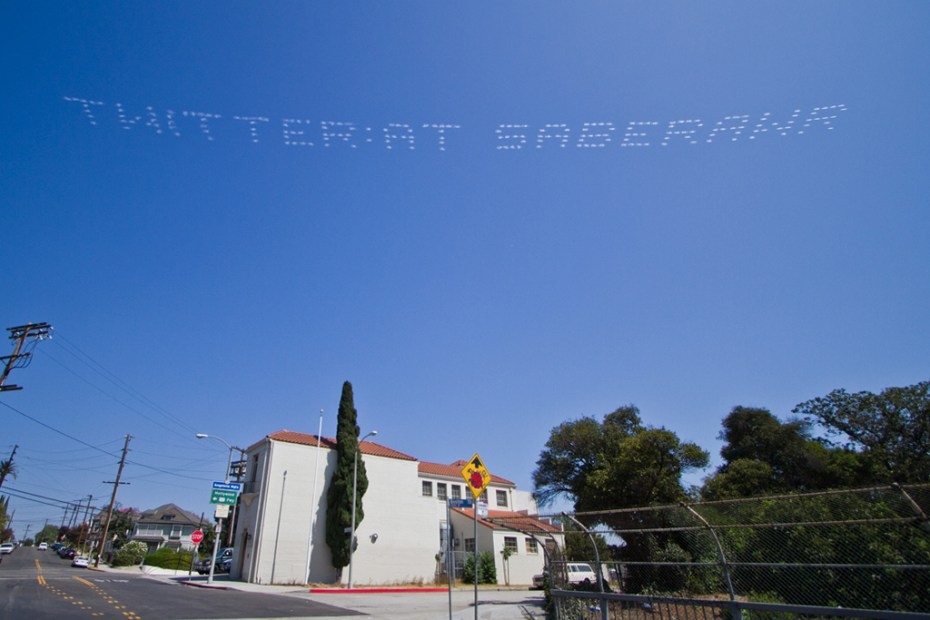 Image of SABER: Plane Skywriting Over Los Angeles City Hall