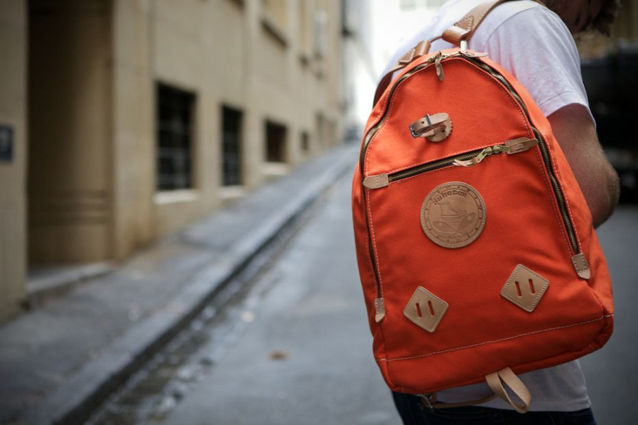 Image of Yuketen Triangle Backpack Orange Waxed Cotton 