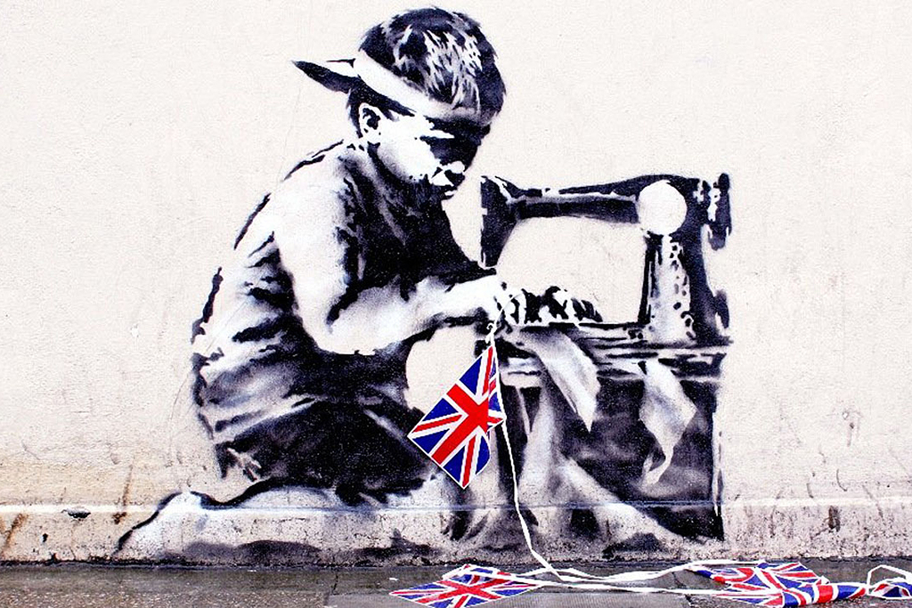 Image of Banksy's Union Jack Child Labour Stencil Chiselled Off The Wall For Auction