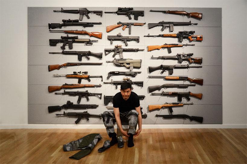 Image of Liu Bolin's Gun Rack Performance @ Eli Klein Fine Art Gallery New York