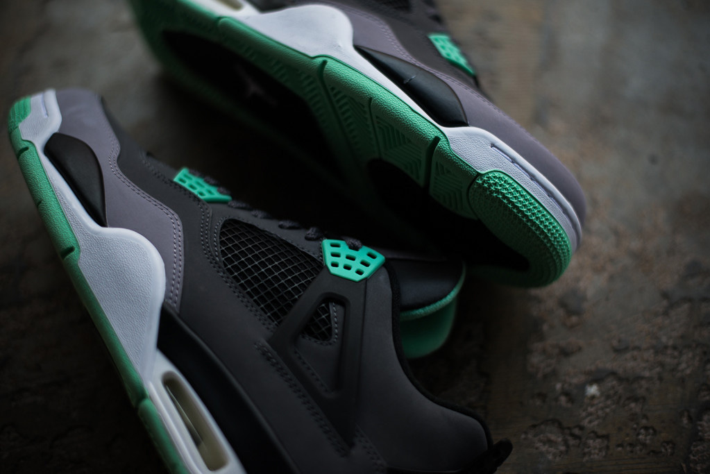 "Image of A Closer Look at the Air Jordan 4 Retro ""Green Glow"""