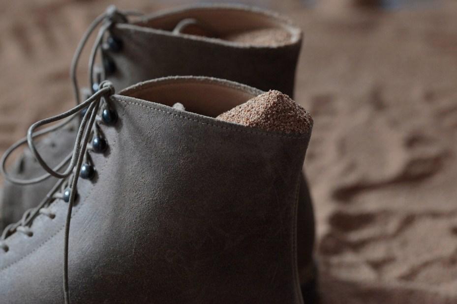 Image of Takahiro Miyashita of TAKAHIROMIYASHITATheSoloIst. and Takayuki Fuji of nonnative Launch Sand.W.Man Footwear Collection