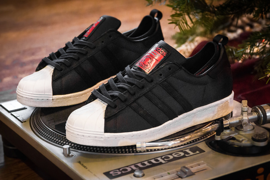 "Image of A Further Look at the Run-D.M.C. x Keith Haring x adidas Originals ""Christmas in Hollis"" Superstar 80s"