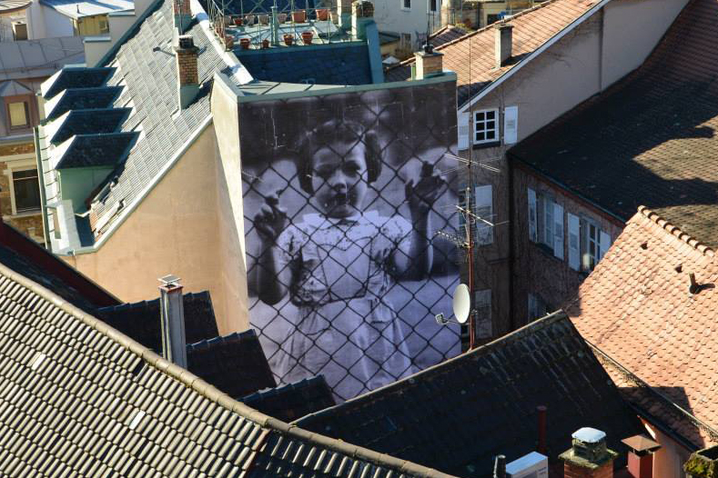 "Image of JR ""UNFRAMED"" Project In Baden-Baden, Germany"