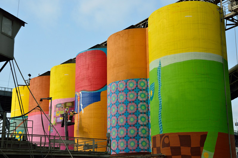 "Image of Os Gemeos Paints ""Giants"" On Vancouver Silos"