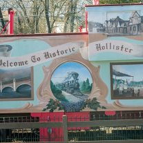 Mural of early Hollister painted on the side of a caboose. Branson's rail connection was responsible for its early growth as a tourist destination.