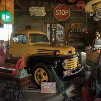 The tableau of mostly roadside related antiques is amazingly arranged.