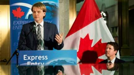 """Immigration Minister Chris Alexander, shown here giving an update on the express entry last month in Toronto, has said the new immigration system was getting  """"impressive results"""" in its first month."""
