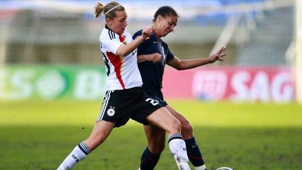 Germany's Lena Goebling (left) and Shanon Boxx of the U.S. vie for the ball. Goebling told Germany's Bild newspaper that the German team has found gender testing amusing. But for some players, just the idea of it is humiliating.