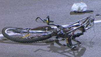 A bicycle lies at the scene of a hit and run that killed a cyclist early Thursday morning in Toronto.