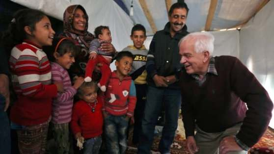 Some Syrian refugees sponsored by the government say they're not getting much help in Canada from Immigration Minister John McCallum, right, and would rather go back to their refugee camps overseas, such as this one in Lebanon.