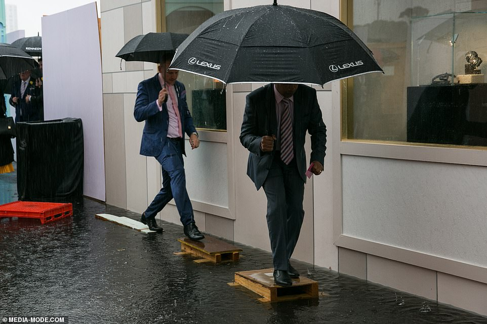 Melbourne Cup Chaos As Torrential Rain Threatens To Ruin