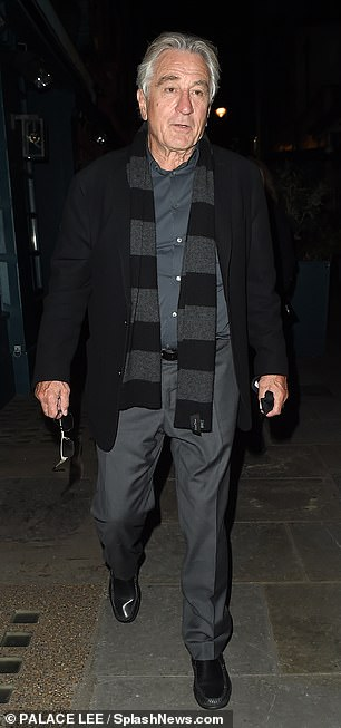 Icon: The legendary Hollywood star looked relaxed as he strolled through London