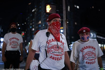The Guardian Angels perform a night patrol of the Upper West Side, Manhattan, New York, amid growing concerns about hundreds of homeless recently moved into hotels by the city on August 10