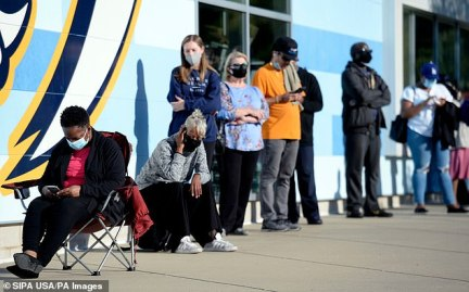 TENNESSEE: People wait on line in front of the Ford Ice Center to fill out a ballot Wednesday at the Southeast Library