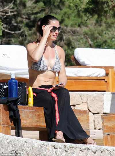 Kirsty Gallacher flaunts her toned physique in skimpy red crop top as she works up a sweat ...