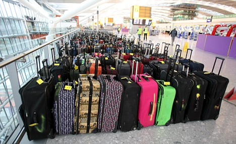 BA lost 450,000 passenger bags this summer - one in every 53 pieces