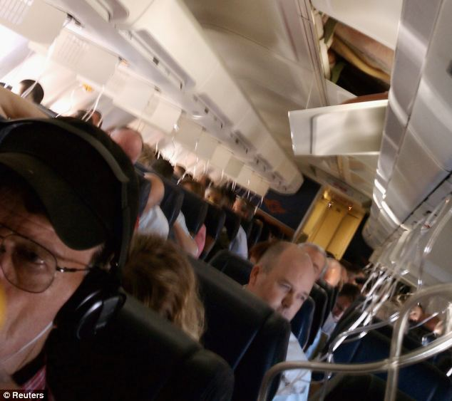 Aircraft in emergency landing after hole above passengers\u0027 heads