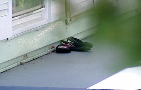 Evidence: A pair of sandals can be seen outside the house in Asheville, North Carolina, where Naiyana Patel is said to have butchered her two young daughters