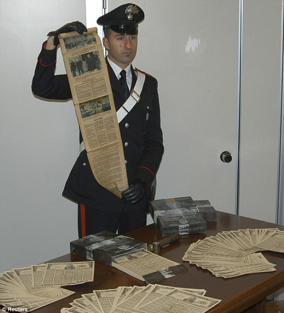 Paper trail: An Italian Carabinieri shows off the stash fake bonds
