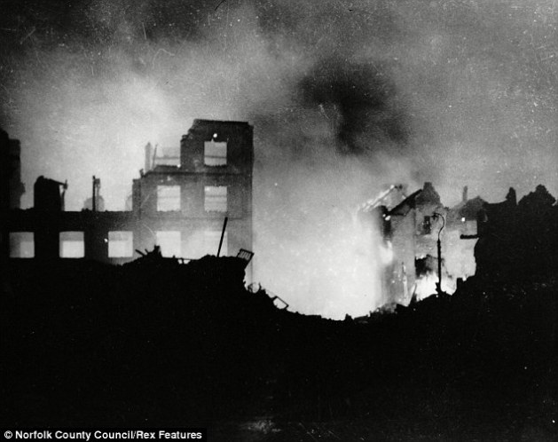 Destruction: The Wincarnis works in Westwick Street ablaze following one of the Luftwaffe's raids