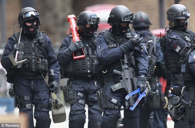 British Police Combat Team Tooled up and ready to raid the - mock police report