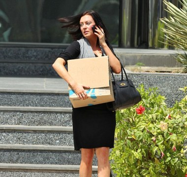 Fired: A tearful Miss Blake emerges from the building, carrying a box under her arm