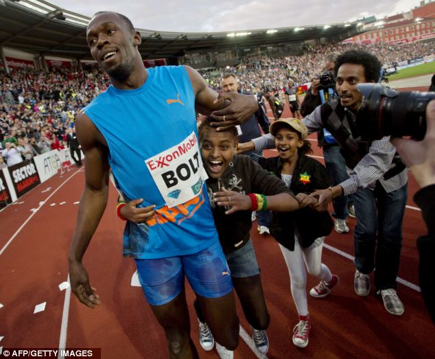 Usain Bolt Sets Crashes Into Flower Girl At End Of 100m