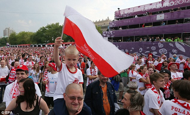 Flying the flag: Poland and Greece fans show their support