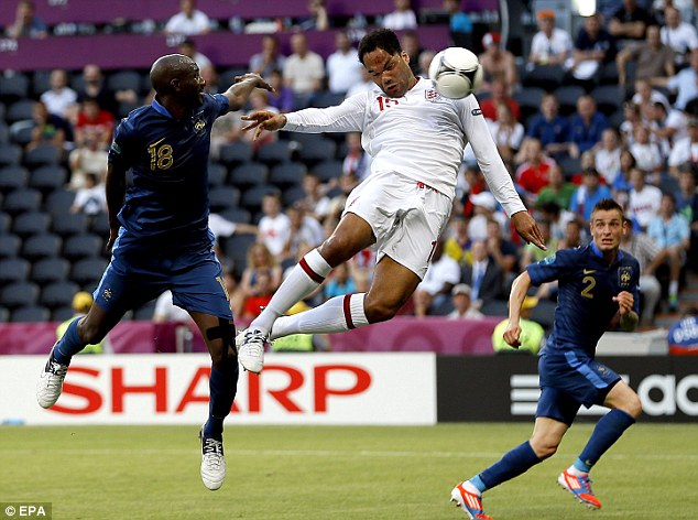 Head boy: Joleon Lescott put England in front with a thumping, towering header from Steven Gerrard's free-kick