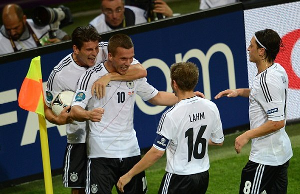 Party time: Germany celebrate Lukas Podolski's opening goal against Denmark
