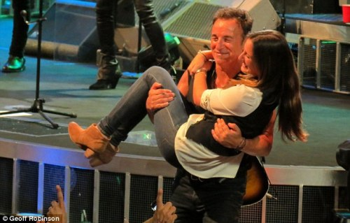 Daddy's little girl: After their dance, Bruce carried his daughter back to her place in the audience
