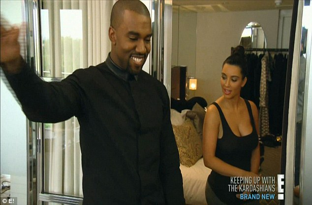 New couple: Kim and Kanye share a laugh before she gets dressed