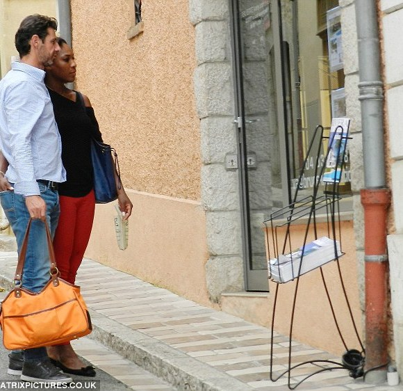 Day out: They looked at listings for properties along the French Riviera on their stroll