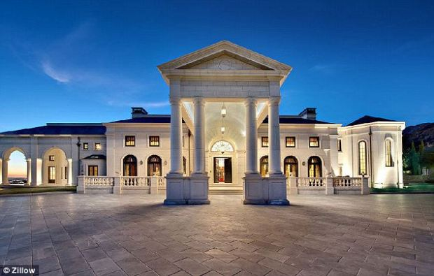VIP: A covered entrance way, complete with pillars, is just begging for a red carpet