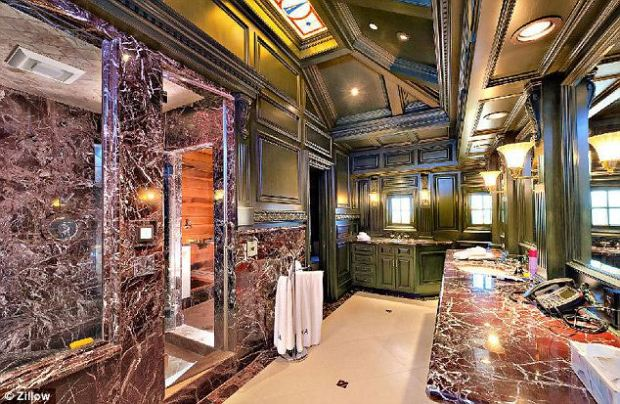 This marble-lined bathroom is just one of 10 dotted throughout the property