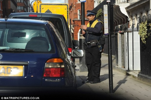 Doing a deal: The traffic warden, employed by the UK's biggest parking contractor NSL, allegedly said he could 'sort something out' if he was paid - and would stop any local wardens putting a ticket on the car