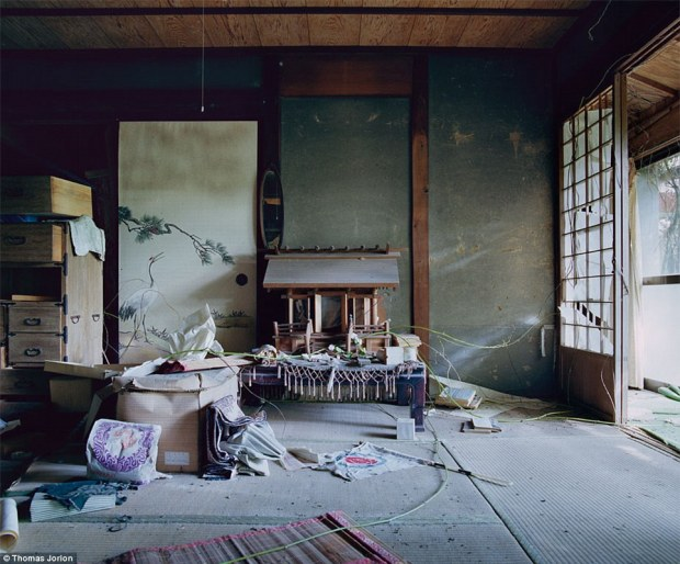 Dust to dust: A traditional Japanese room with an ancestral shrine and a tatami mat on the floor