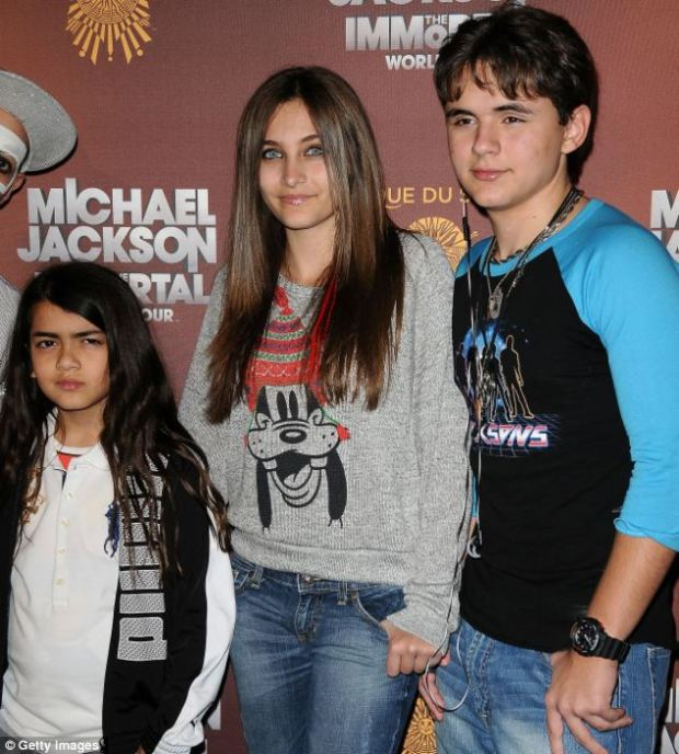 Caught up: Michael Jackson's three children Blanket, Paris and Prince Michael have had a difficult relationship with their aunts and uncles since the death of their father