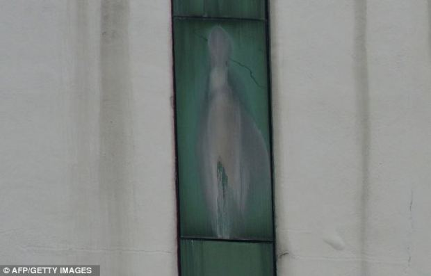 An image said to be the Virgin Mary appears on the window of a Malaysian hospital in Subang outside Kuala Lumpur