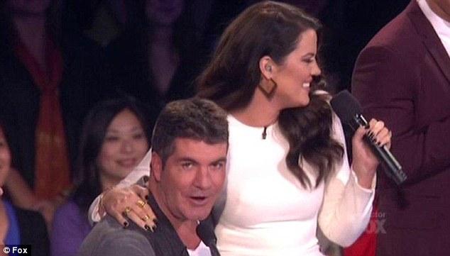 Khloe Kardashian Makes Simon Cowell Turn A Shade Of Bright