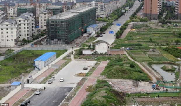 Another family initially agreed to sell the property in Taizhou but changed their minds once work on the road had started